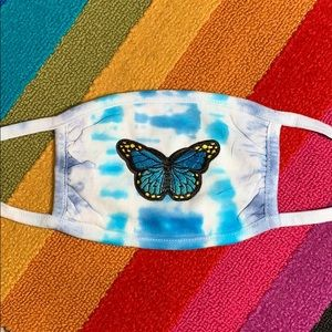 Tie-dye mask with embroidered butterfly